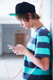 Teenager with gadget Royalty Free Stock Photography