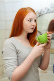 Teenager Gargling Throat In Bathroom Royalty Free Stock Photos