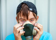 Teenager in Gas Mask Stock Images