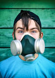 Teenager in the Gas Mask Royalty Free Stock Photography