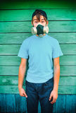 Teenager in the Gas Mask Royalty Free Stock Photos