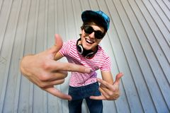 Teenager gesturing. Young man gesturing and smiling Royalty Free Stock Photo