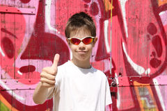 Teenager gesturing thumbs-up Royalty Free Stock Image