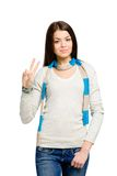 Teenager gesturing victory sign Royalty Free Stock Images