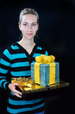 Teenager with gift boxes Royalty Free Stock Images