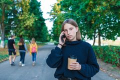Free Teenager Girl 13-15 Years Old, Autumn Day Summer City, Parents Calling Phone, Casual Clothes Sweater, Listening Voice Stock Photography - 165475852