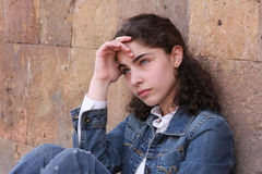 Teenager girl. Thinking teenager girl on wall background Stock Photos