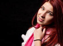Teenager girl. Happy teenager girl smiling at camera on black background Stock Image