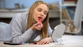 Free Teenager Girl Applying Red Lipstick, Looking In Mirror, Getting Ready To Go Out Stock Photography - 137521792