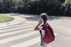 Girl with backpack going to school and talking on the phone stock photos