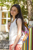 Teenager girl with backpack outdoors Stock Photography