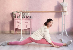 Teenager girl in ballet class hall exercise split. Close up photo stock photography