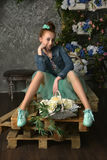 Teenager girl with a basket of flowers Stock Images