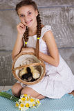 Teenager girl with basket full of chicks Royalty Free Stock Photo