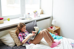 Teenager Girl on Bed with Laptop Stock Photos