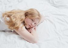 Teenager girl on bed Royalty Free Stock Photo