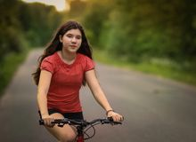 Teenager girl with bicycle country summer outdoor portrait Stock Photography