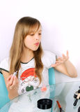 Teenager girl blowing on painted nails Stock Photos