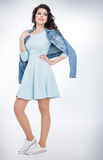 Teenager girl in a blue dress Royalty Free Stock Photography