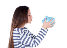Teenager girl with blue piggy bank Royalty Free Stock Photography