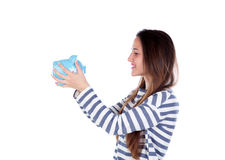 Teenager girl with blue piggy bank Stock Photography