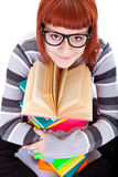 Teenager girl and book. Teenager girl smiling and reading book, close up Stock Photos