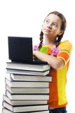 Teenager girl with books and laptop smile. Positive teenager girl with books and laptop, isolated on white Stock Photography