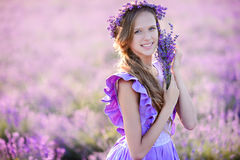 Beautiful girl in a field of lavender on sunset. stock images