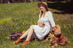 Teenager girl with bunny and dog in the nature Royalty Free Stock Images