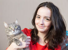 Teenager girl with a cat stock images