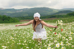 Teenager girl  on the chamomile meadow Royalty Free Stock Photography