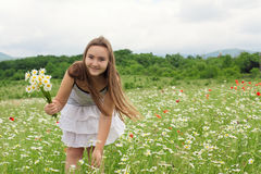 Teenager girl on the chamomile meadow Stock Image