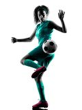 Teenager girl child  soccer player isolated silhouette. One teenager girl child  playing soccer player in silhouette isolated on white background Royalty Free Stock Images