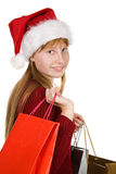 Teenager girl in christmas hat with shopping bags Royalty Free Stock Photo