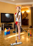 Teenager girl cleaning floor at living room with swab Royalty Free Stock Photo