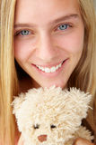 Teenager girl close up with teddy bear Stock Image