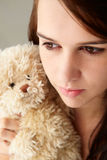Teenager girl close up with teddy bear. Looking off camera Royalty Free Stock Photo