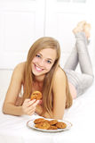 Teenager girl with cookies Stock Image