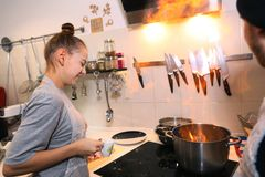 Teenager girl cooking. Moscow, Russia, December 16, 2017: Unidentified teenager girl cooking pasta on culinary master class event party signifying final days of Royalty Free Stock Photography