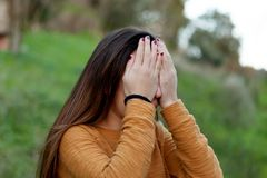Teenager girl covering her face Stock Photography