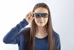 Teenager girl with 3d glasses looking at camera royalty free stock images