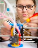 Teenager girl with 3d printe. education. Technology stock images