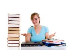 Teenager girl on desk. Happy smiling teenager girl on desk doing studying and homework Stock Photography