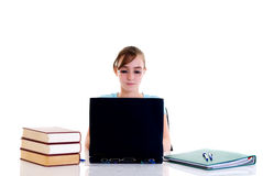 Teenager girl on desk Stock Photos