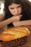 Teenager girl dieting loose weight restrict eating bread. Loaf hungry Royalty Free Stock Photo