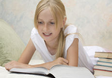 Teenager girl do homework Stock Photography