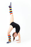 Teenager girl doing gymnastics exercises on a white background Stock Images