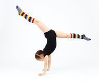 Teenager girl doing gymnastics exercises on a white background Royalty Free Stock Images