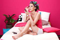 Teenager girl doing her make up in her room Royalty Free Stock Photo