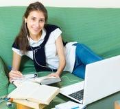 Teenager girl doing homework Royalty Free Stock Photography